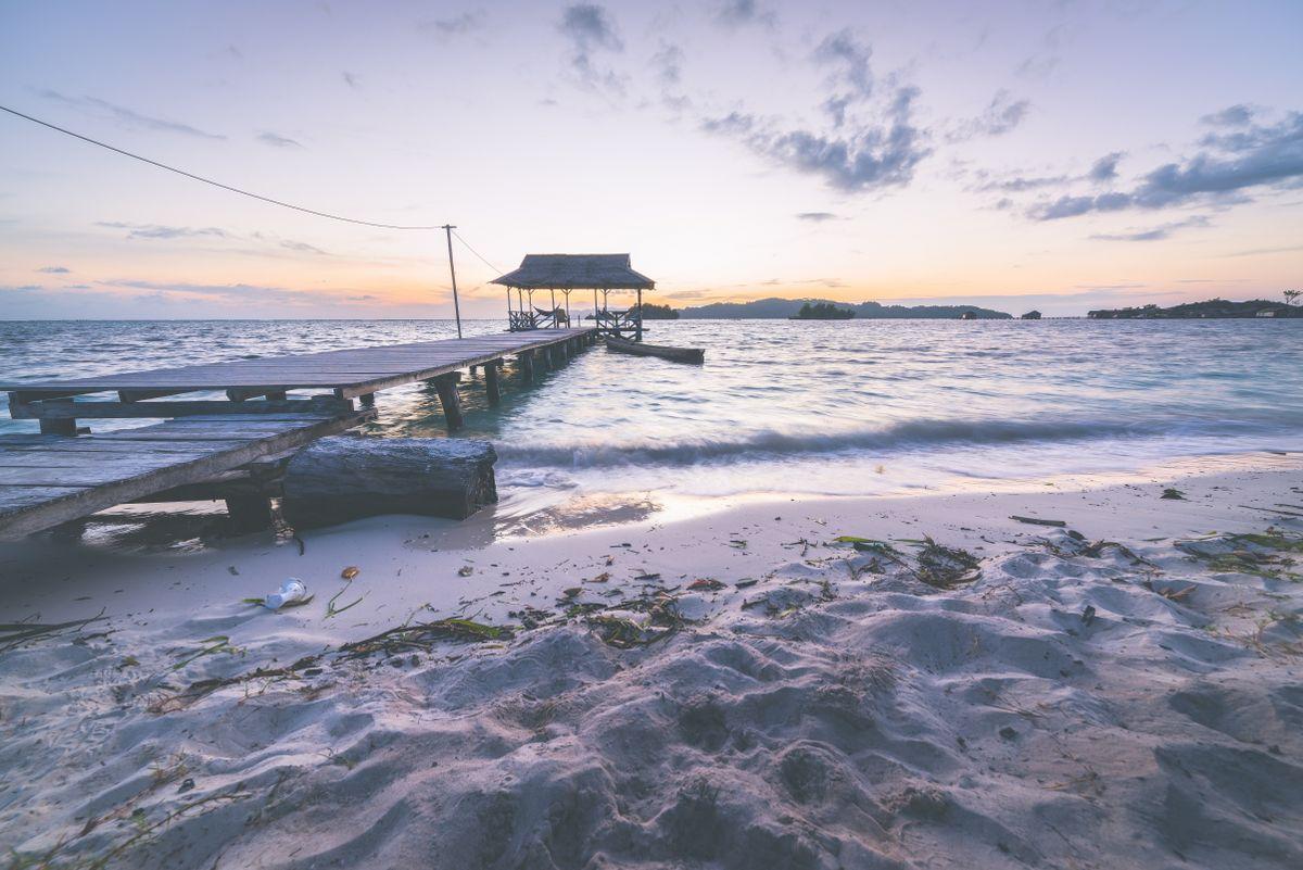 tourist-beach-resort-at-dawn-marsala-toned-image